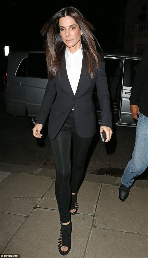 Sandra Bullock looks androgynous in a monochrome suit as