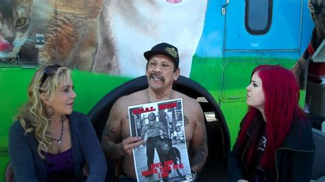 Lacey Sculls with actor Danny Trejo discussing spaying and