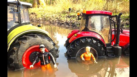 BRUDER TRAKTOR CLAAS and Case In The Mud - YouTube